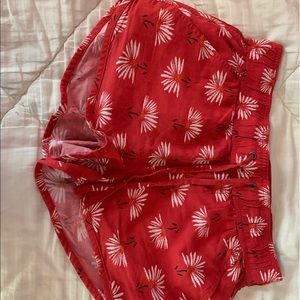 So red and white flower shorts
